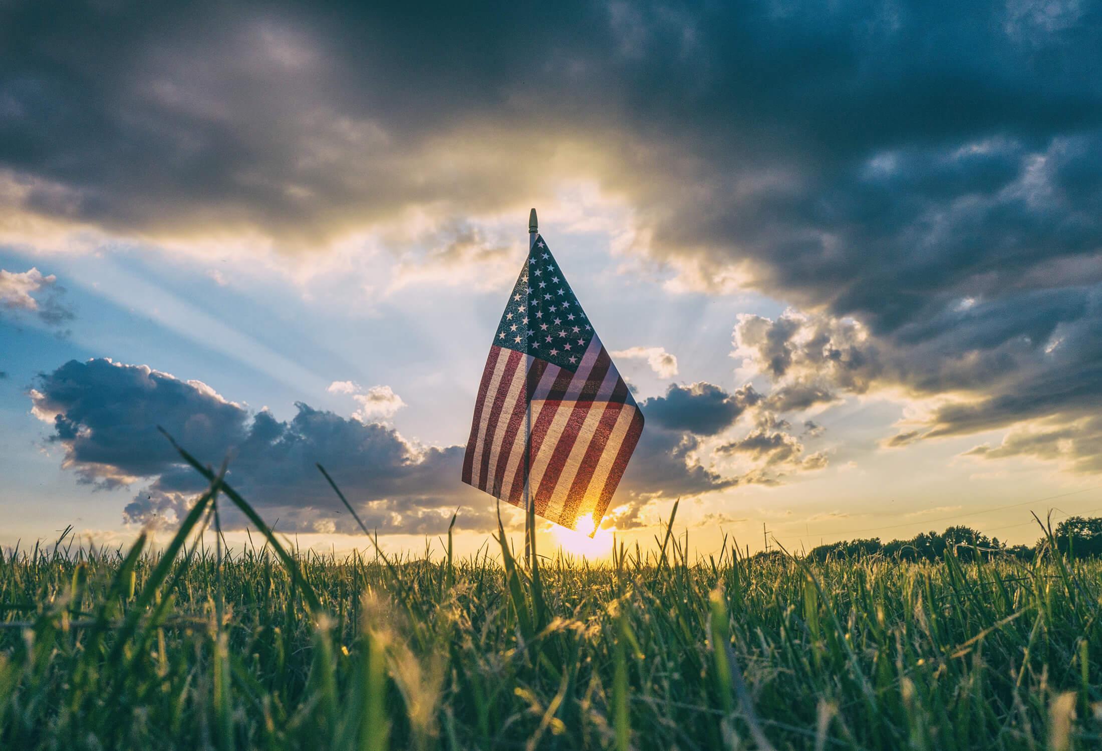 an american flag in a field